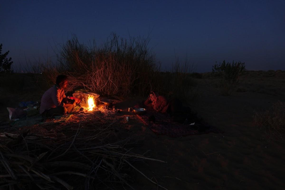 India. Rajasthan Thar Desert Camel Trek. Talking about village life with Punja