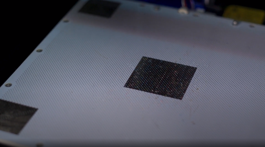 Perforated bed surfaces exhibit excellent adhesion at the cost of requiring rafts to be 3D printable.