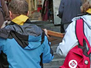 Photo: Pilgrims carry the cross.