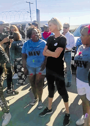Charlize Theron visited Dimbaza to motivate children as part of her Charlize Theron Africa Outreach Project.