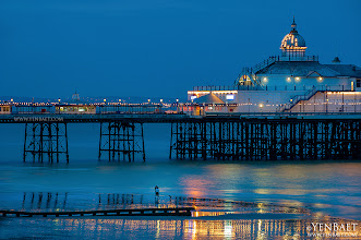 Photo: Twilight | Blue Hour at Eastbourne Pier - Eastbourne - East Sussex, U.K.  Eastbourne Pier is a seaside pleasure pier in East Sussex that was formally opened by Lord Edward Cavendish in 1870. This Victorian pier, one of the last remaining in England, is built on stilts that rest in cups on the seabed which allows the whole structure to move during rough weather. At the end of the pier is a tower that often serves as a viewing area during the annual air show. The city of Eastbourne, dubbed as the sunniest place in England, attracts over 4 million visitors a year.  #Eastbourne   #England   #UK   #Travel   #Photography   © Yen Baet - www.YenBaet.com. All Rights Reserved. Join me on Facebook at www.facebook.com/YenBaetPhotography.