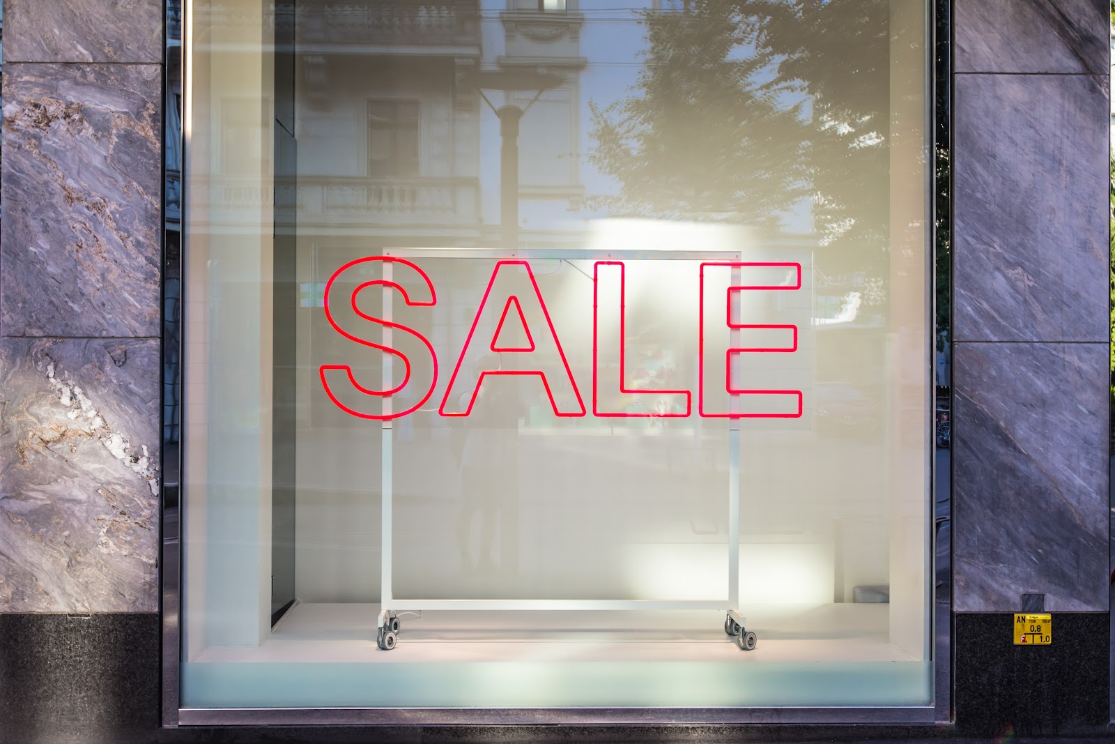 A display window with the word sale