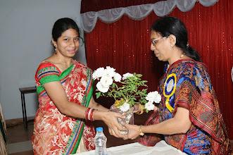 Photo: Ms. Sushma honoring Dr. M. Savithri - Organizing Secretary
