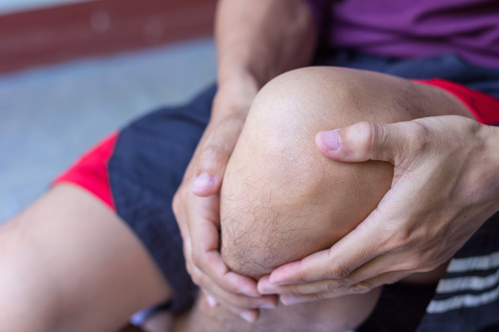 Young man with knee pain