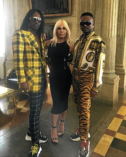 Local music and art duo FAKA with Italian designer Donatella Versace at Milan Fashion Week at the weekend.