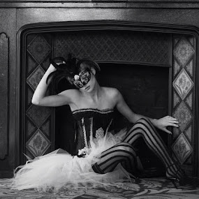 Fireplace fancy  by Phil Barker - Black & White Portraits & People ( female. mono. hearth. mask. stockings. corset. lace. tiles. fireplace. )