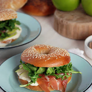 Sesame Bagel Sandwiches with Prosciutto, Arugula, Apple and Honey Cream Cheese.