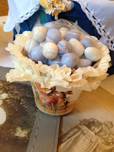 Photo: I love the way the Cadbury minis look when bunched in one or two colors.  I chose white and blue for this basket.  I took a handful of each and put them in a clear cello bag.  Then I tucked the bag inside the little pot.
