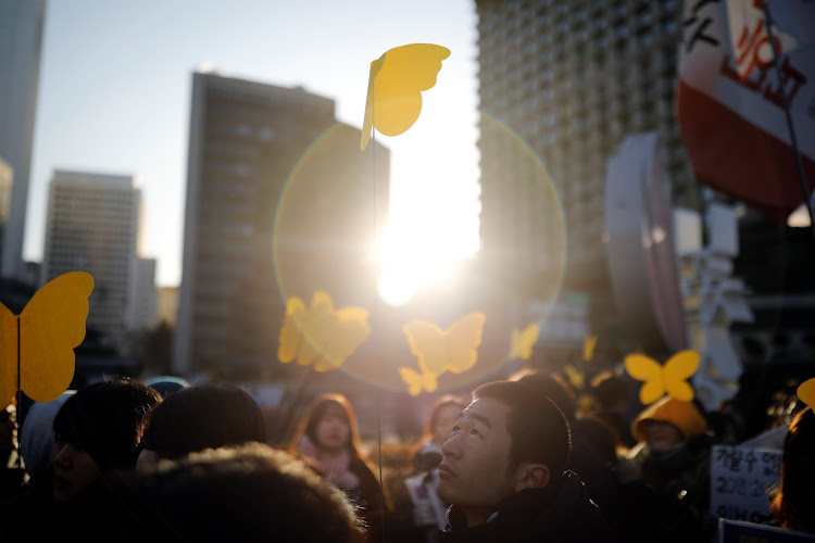 Yellow butterflies are dedicated to a former South Korean 'comfort woman' during her funeral in Seoul.