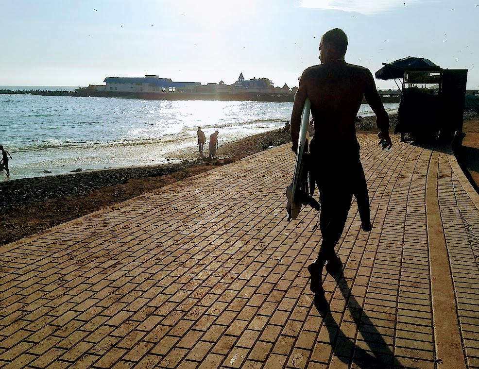Surfer on El Malecon boardwalk in Lima, Peru. Photo by Shelley Seale.