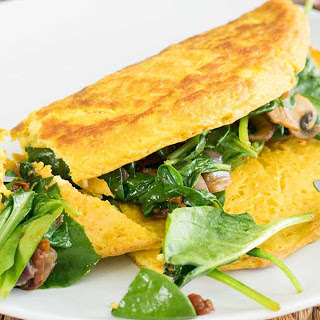 Chickpea Flour Omelet With Sun-Dried Tomatoes, Mushroom, and Spinach Filling [Vegan, Gluten-Free].