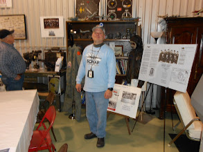 Photo: Kenneth Berry poses in front of the WWII paraphenalia ... an excellent collection