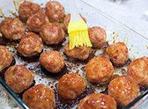 Place meatballs on a greased or sprayed jelly roll  or sheet pan with...