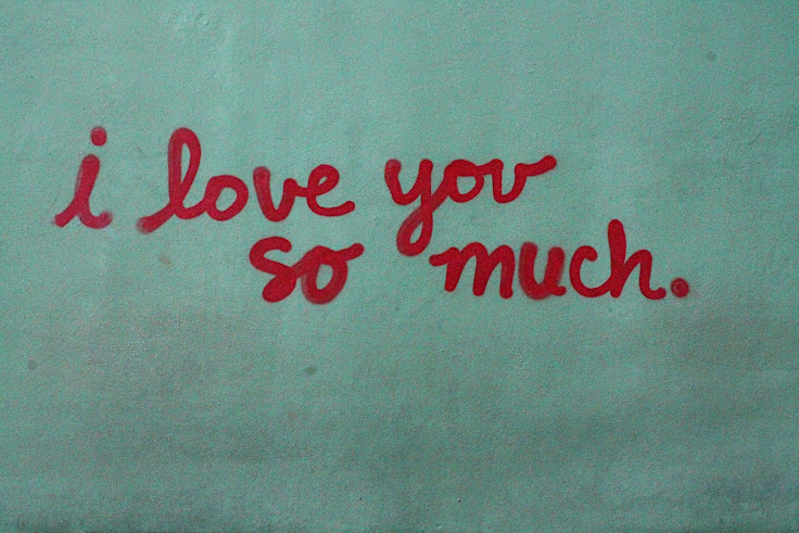"The iconic ""I love you so much"" graffiti on the side of Jo's."