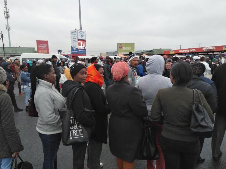 Long queues of frustrated commuters in Site C, Khayelitsha, Cape Town. Taxi owners said they were overwhelmed by the number of passengers. Picture: PHILANI NOMBEMBE