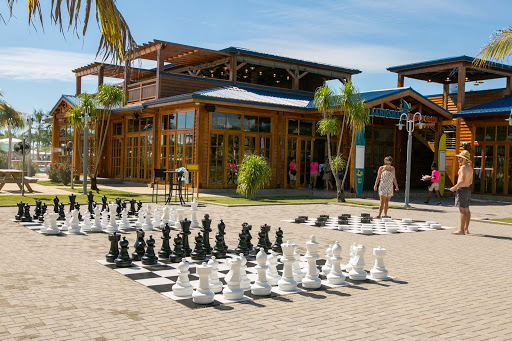 harvest-caye-checkers-and-chess.jpg - Guests can play on oversize checkers and chessboards at Harvest Caye in Belize.