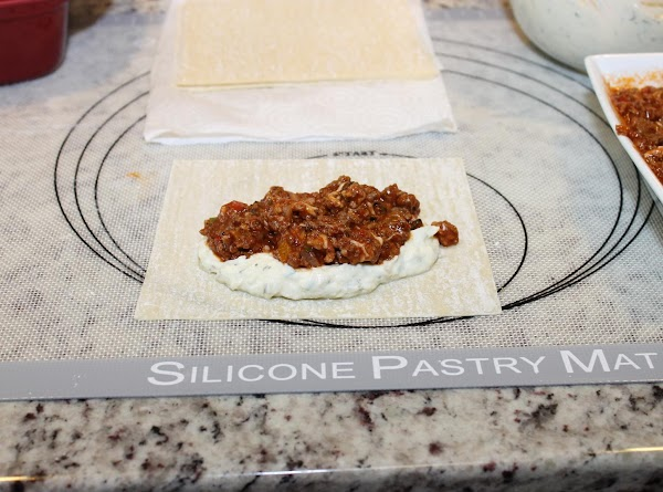 For each lasagna roll up, take one wrapper and place about 2 tablespoons of...