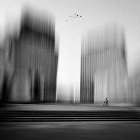 Urban cycling by Rafael Kos - Digital Art Places ( urban, person, cycling, black&white, city )