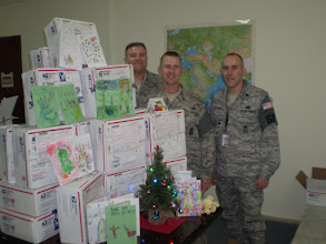 Photo: Master Sgt. Miller, Tech. Sgt. Tucker and Lt. Col. Aldridge of the Minnesota National Guard's Duluth-based 148th Fighter Wing, currently serving in Afghanistan, received dozens of gift boxes donated by Minnesota school children and other supporters this December.