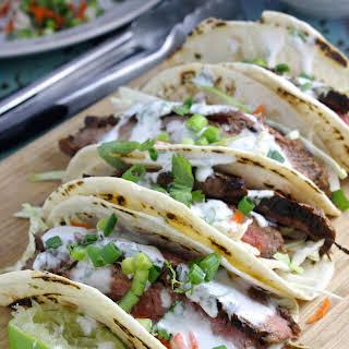 Flank Steak Tacos with Cilantro Lime Yogurt Sauce.
