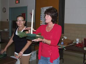Photo: Barbara McCabe leading a Christmas Centerpiece Workshop at Mann Senior Center.
