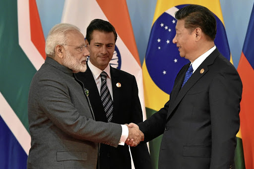 Chinese President Xi Jinping, right, and Indian Prime Minister Narendra Modi, left, shake hands before the group photo session on the sidelines of the 2017 Brics summit in Xiamen, Fujian province in China, on September 5 2017. Picture: REUTERS