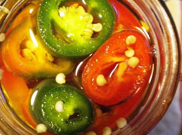 Pack sweet jalapeno peppers and juice into sterile jelly jars or pint jars to...