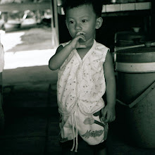 Photo: Child of Ho Chi Minh village town
