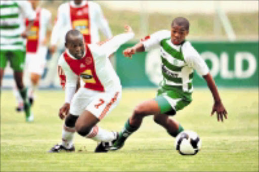 MELEE: Gert Schalkwyk of Bloemfontein Celtic and Nhlanhla Shabalala of Ajax Cape Town chasing the ball during their side's match. Celtic won 2-1. 08/02/09. © Backpagepix.