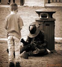 Photo: Boy and old Beggarman