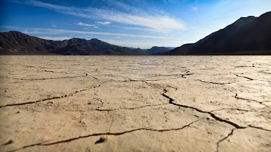 Photo: The Racetrack Playa, Death Valley, CA.  Later on that that night, after it got dark, we walked out onto this same playa and walked for a long time looking for the grandstand. In this vast place its quite easy to misplace a few tons of rock.  My most memorable thing about this place was the silence; close your eyes and the only thing keeping you company was the wind.  #DV2011 #DV2011_RicardoLagos