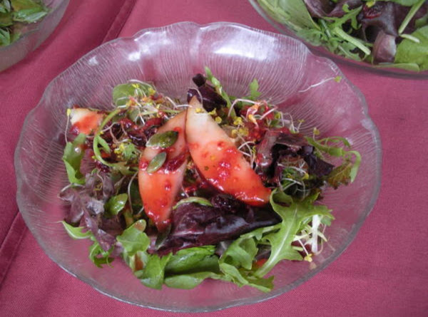 Pumpkin Seed-topped Pear And Arugula Salad With Tangy Raspberry Dressing Recipe