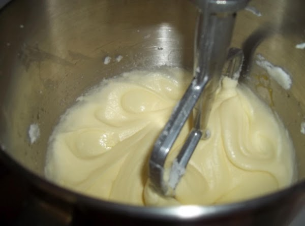 In a small saucepan, melt chocolate in water. Stir in food coloring if desired....
