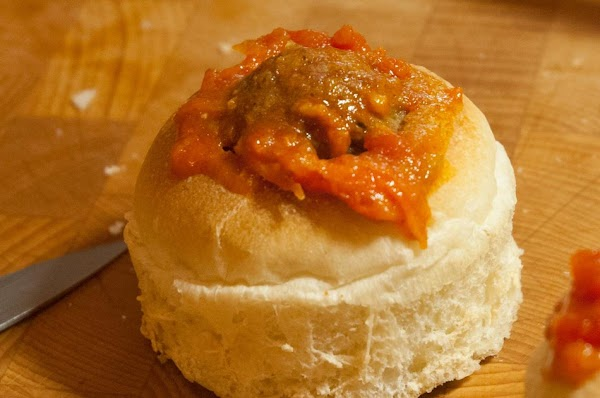 Fill about halfway up with tomato sauce. Place a meatball in the hole, and...
