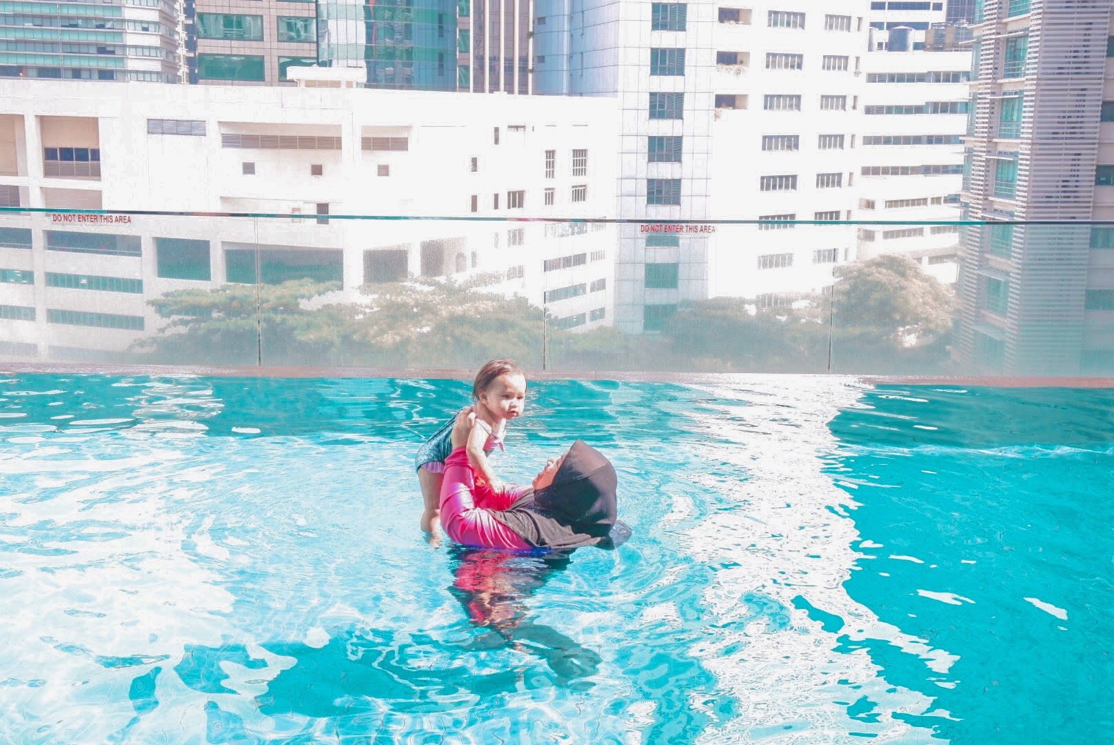 Amira and Zinnirah in the pool at Ramada Suites by Wyndham KLCC