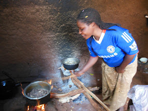 Photo: Mama Tina cooking the goat meat. I've learned a lot about cooking from her.