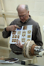 Photo: Stan shows a book with ideas for feature rings