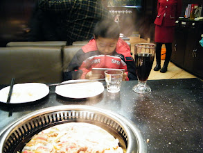 Photo: brought dearest son dined out with fried beef after a sore afternoon waiting before meeting my son, who brought away by his jealous mom, a bitchy small woman. we both liked the food, even son played a lot on his fonepad during dinner.