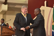 Veteran teacher William Smith is honoured by President Cyril Ramaphosa for his contribution to maths and sciences.