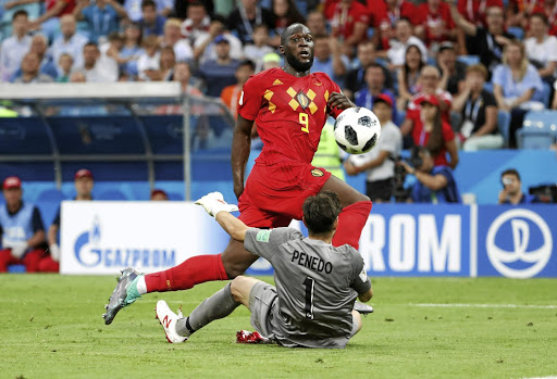 Red alert: Belgium striker Romelu Lukaku chips the ball over Panama goalkeeper Jaime Penedo for his second and Belgium's third goal in their World Cup Group G match in Sochi on Monday. Picture: REUTERS