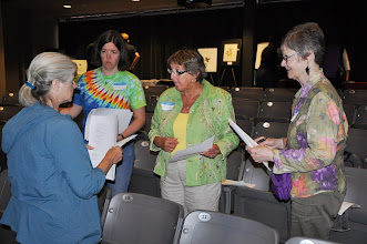 Photo: Planning the reading from the 25th anniversary Haiku Northwest anthology are Dianne Garcia, Tanya McDonald, Angela Terry, and Connie Hutchison.