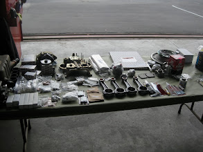 Photo: Parts laid out on a table for easy identification when assembling the engine.