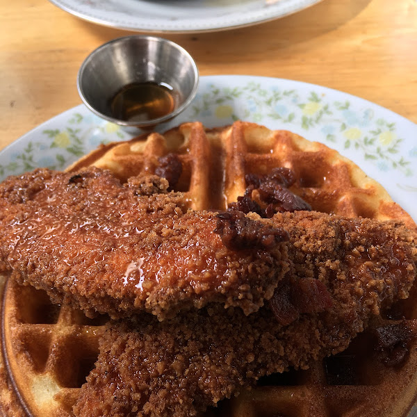 Celiac safe chicken and waffles with bacon bits and maple syrup. Soooooo good. So good I worried and kept asking about GF.