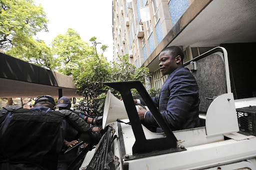 Shepherd Bushiri addresses his supporters after being released on R100,000 bail yesterday. Questions have since been raised as to why he was transported in a police armoured vehicle.