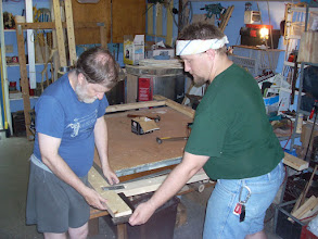 Photo: These parchment frames are designed to be broken down later.  Here we are attaching the bracket to the boards.