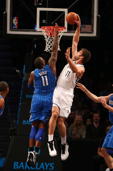Photo: NEW YORK, NY - JANUARY 28:  Brook Lopez #11 of the Brooklyn Nets dunks the ball against Glen Davis #11 of the Orlando Magic during their game at the Barclays Center on January 28, 2013 in the Brooklyn borough of New York City. NOTE TO USER: User expressly acknowledges and agrees that, by downloading and/or using this photograph, user is consenting to the terms and conditions of the Getty Images License Agreement.  (Photo by Al Bello/Getty Images)