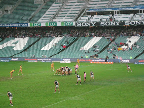 Photo: Day 2 in Sydney was back to rain.  We took the opportunity to go to a National Rugby League game.  Notice how all the spectators are pushed way back under the overhang.  So were we, thank goodness.