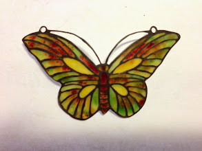 Photo: Plique-à-Jour Enamel Button - Butterfly - Oxidized Sterling Silver, Plique-a-Jour Transparent, semi-opaque, and opalescent enamels - approximately 33mm (h) x 55mm (w) - $495.00 US This button is a miniature depiction of a Tiffany lamp screen.