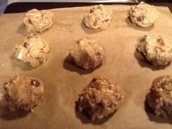 PREHEAT OVEN TO 375 n LINE COOKIE SHEETS WITH PARCHMENT PAPER.  SPOON A...