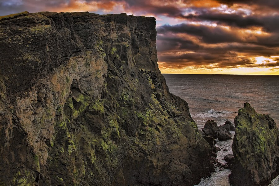 Cliff in south Iceland. by Konrad Ragnarsson - Landscapes Mountains & Hills ( clouds, sky, mountain, nature, konni27, cliff, sea, ocean )